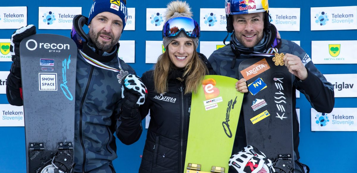 ROGLA,SLOVENIA,02.MAR.21 - SNOWBOARDING - FIS Snowboard World Championships, parallel slalom, ladies, men, award ceremony. Image shows the rejoicing of Andreas Prommegger, Julia Dujmovits and Benjamin Karl (AUT).